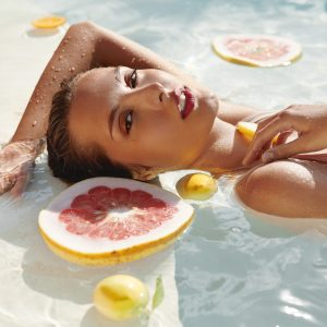 Hydrafacial Beautiful Young Girl's Portrait In Pool With Fresh Tropical Fruits.