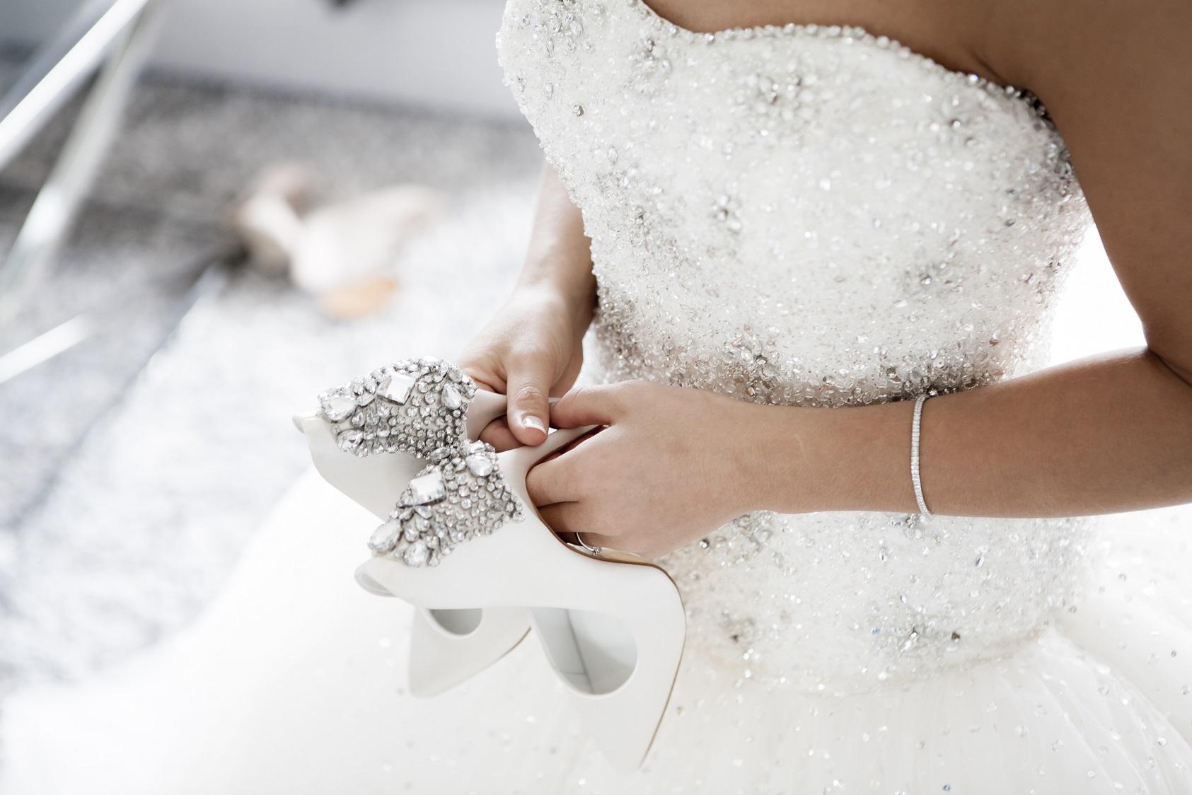 Bride Holding Her Bridal Shoes