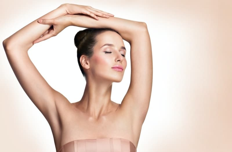 Woman with her arms up, Botox for underarm sweating