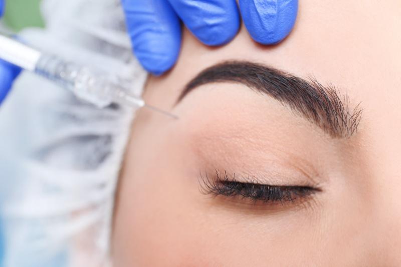 Woman undergoing Botox for eyebrows