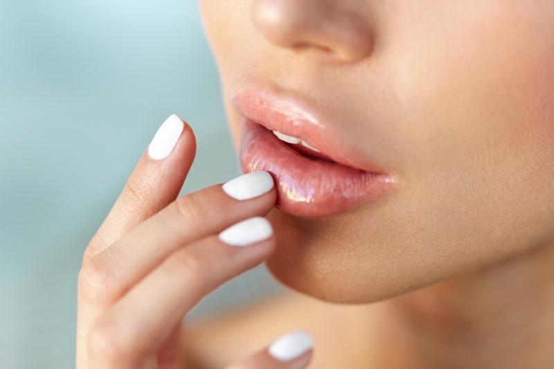 dissolving lip fillers, girl touching her lips