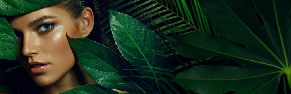 A woman hiding behind leaves