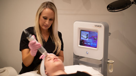 Skin care A woman receiving skin rejuvenation treatment at Vibrant Skin Bar by Jalair Whitman