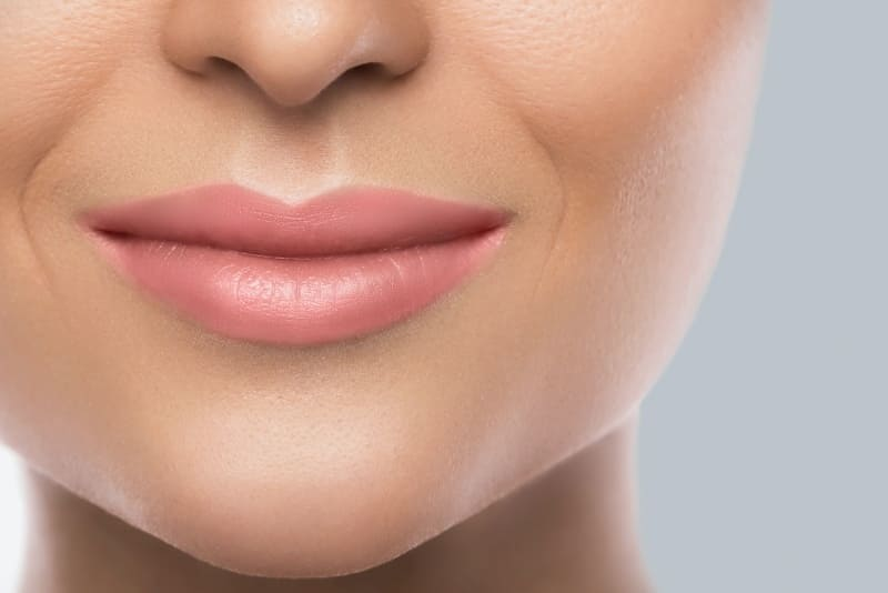 An image of female lips and nasolabial folds